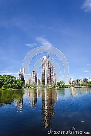 City building near a lake