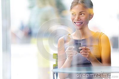 City cafe lifestyle business woman on smartphone