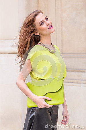 City chic girl with neon blouse Stock Photo