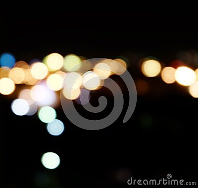 City lights in the background with blurring spots of light