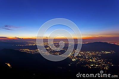 City lights at night along mountains in Hong Kong