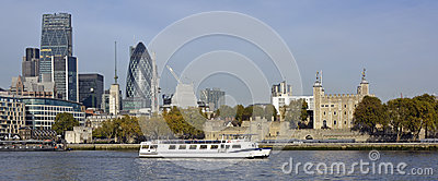 City of London skyline with river tour boat