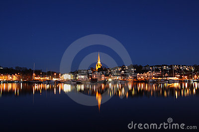 City at night with waterfront