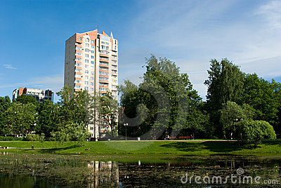 City park with modern apartment houses
