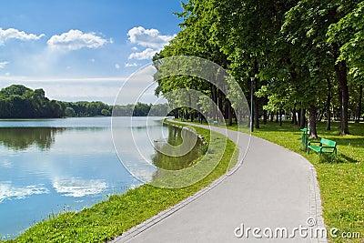 A city park pond shore alley.