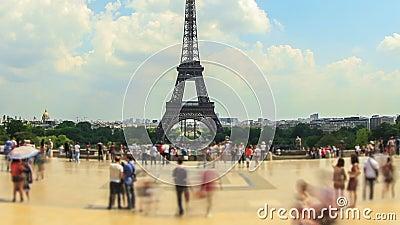 City Pedestrian Traffic Time Lapse Eiffel Tower Fisheye Pan. V54. Panning fisheye pedestrian traffic time lapse with Eiffel Tower in background stock video footage