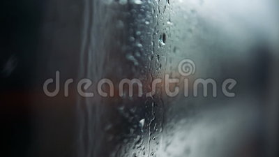 City in rain. A view of a city in rain through the window of a moving tram. Shallow DOF, focus on raindrops on the window stock footage