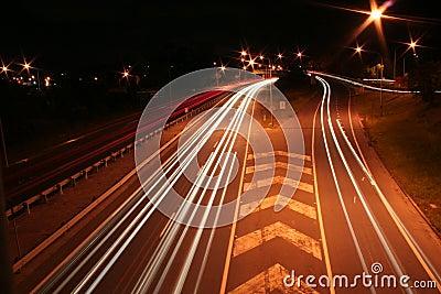 City road with car light streaks