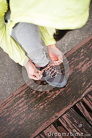 City runner lacing sport footwear before training