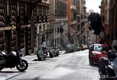 City street with parked cars and motocycles