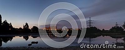 City sunrise over pond