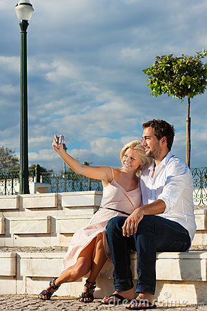 City tourism - couple in vacation on a bench