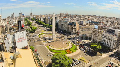 City Traffic Time Lapse Buenos Aires Above Zoom. V78. Zooming city traffic time lapse of Buenos Aires cityscape and streets from above stock footage