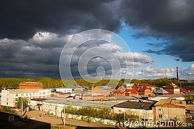 City under black clouds