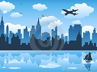 Cityscape wit blue sky and its reflection