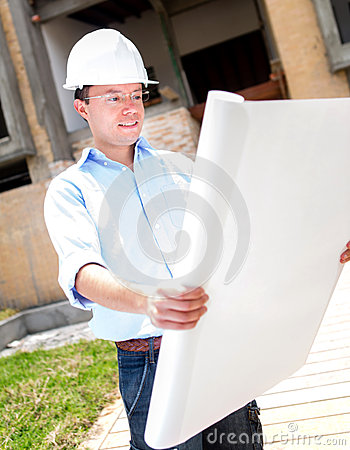 Civil engineer looking at blueprints