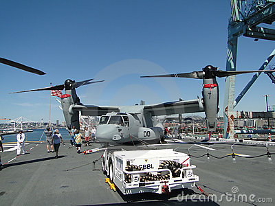 Civilians inspect an  MV-22 Osprey Editorial Photography