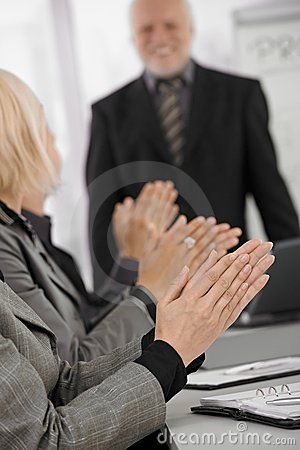 Clapping hands in focus on businessmeeting