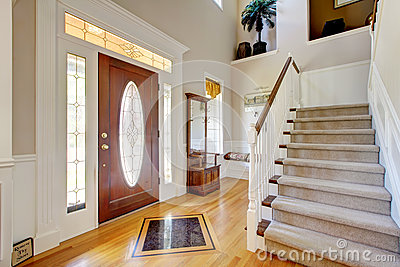 Classic american home entrance interior with staircase for Classic american house interior