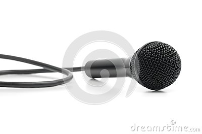 Classic black microphone lying on white