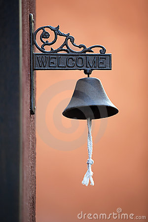 Classic Brass Door Bell with Orange Wall
