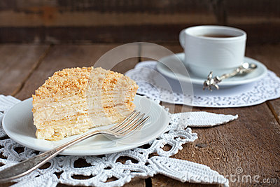 Classic Cake Napoleon of puff pastry with custard cream on a pla