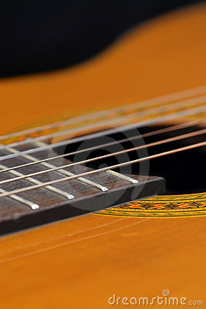 Classic Guitar (Spanish), black background.