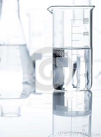 Classic laboratory flasks with a clear liquid