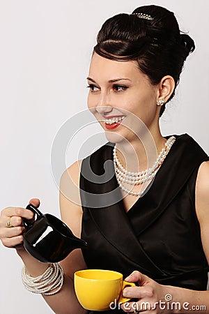 Classic lady serving tea at breakfast