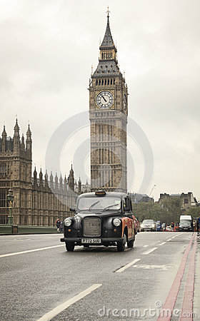 Classic London cab in front of Big Ben clock tower Editorial Image