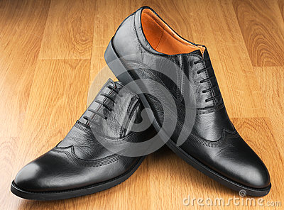 Classic men s shoes stand on the wooden floor