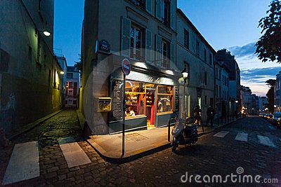 A classic parisian cafe at night Editorial Stock Photo