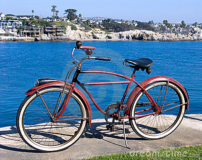 Classic red bicycle at park