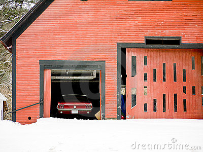 Classic Red Car in Barn