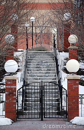 Classic Snow Covered Stairway and Lamp Pillars