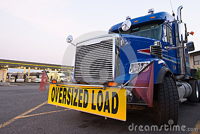 Classic truck big rig blue sign oversized load truck stop