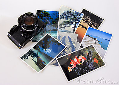 Classic vintage slr film camera with photographs