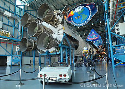 Classic White Corvette and Saturn V Rocket Editorial Photography