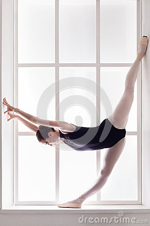 Free Classical Ballet Dancer In Split, Ballerina At Window Sill Royalty Free Stock Images - 91181109