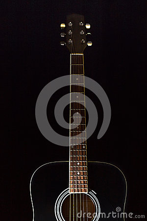 Free Classical Black Guitar On A Black Background Royalty Free Stock Images - 92041299