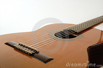 Classical guitar lit from above
