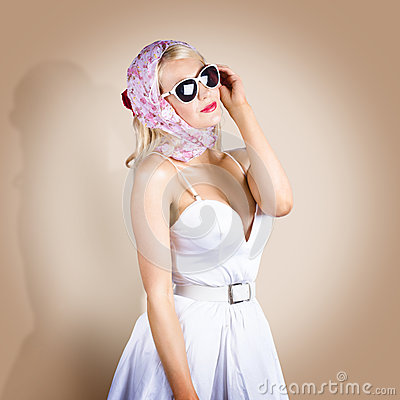 Classical pinup girl posing in retro fashion style