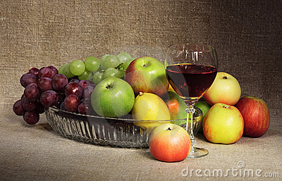 Classical still-life with fruit and glass of wine
