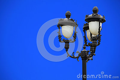 Classical street light against blue sky