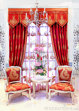 Classical stylish armchairs before window