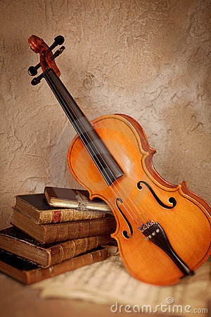 Classical violin and old books