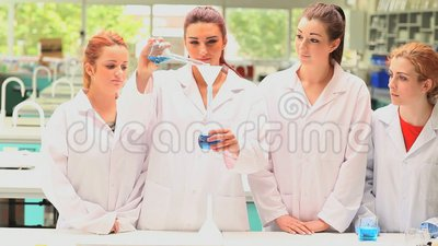 Classmates doing an experiment Stock Photo