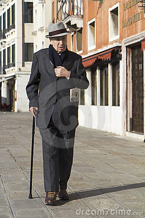 Classy old man walking in Venice. Editorial Stock Image