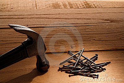 Claw Hammer and Nails on Wood Boards