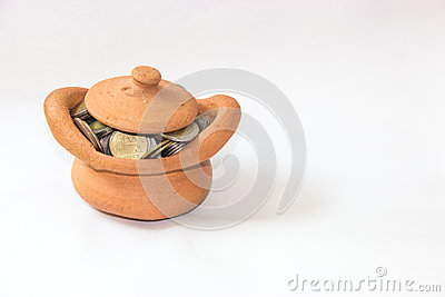 Clay casket full of coins for economy concept Stock Photo